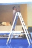 It's a stupid idea to do electrical work off an aluminum ladder in a swimming pool.